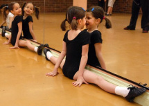 Don Denton/Victoria News staff Seven year old Olivia Brown makes a face at herself in the mirror as she stretches during her dance class for the Junior Apprentice Company at Dance Unlimited. Looking on at left is her twin Georgia.